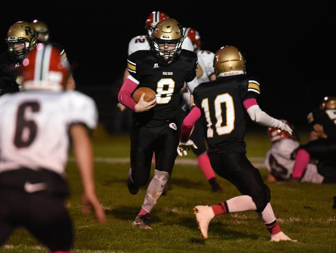 River View's Gannon Unger carries the ball against Coshocton last season. Unger is one of several Black Bears returning as they hope to get the program headed back in the right direction.
