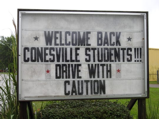 A community sign at the entrance to the Village of Conesville welcomed students back to the fist day of school on Tuesday.