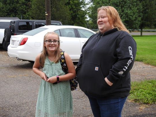 Zoe Hardesty and Rachel Alloway await the start of the first day of school Tuesday at Conesville Elementary School.