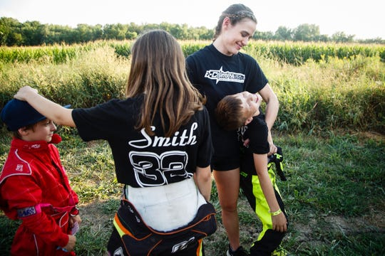 "McKenna Haase, second from right, jokes with Gage Stevens and the rest of her development team during Nationals at the English Creek Speedway on Tuesday, Aug. 7, 2018, in Knoxville. ""When we first started Compass, we weren't out to win,"" said McKenna Haase of her racing development team. ""We were just out to give a kid the opportunity."""