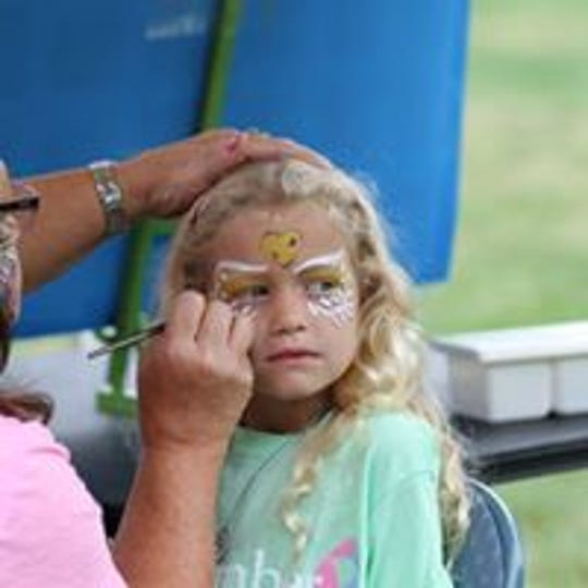 Kids who participate in the annual Iowa SIDS Foundation's Walk for the Future get their faces painted.