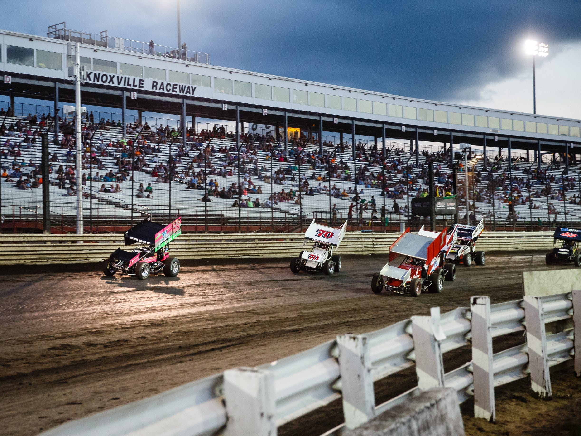 "Driver of the 55 sprint car McKenna Haase, leads a group around the dirt track at Knoxville Raceway on Saturday, July 14, 2018, in Knoxville. ""You're essentially trying to control chaos,"" Haase said of driving her 360 sprint car."