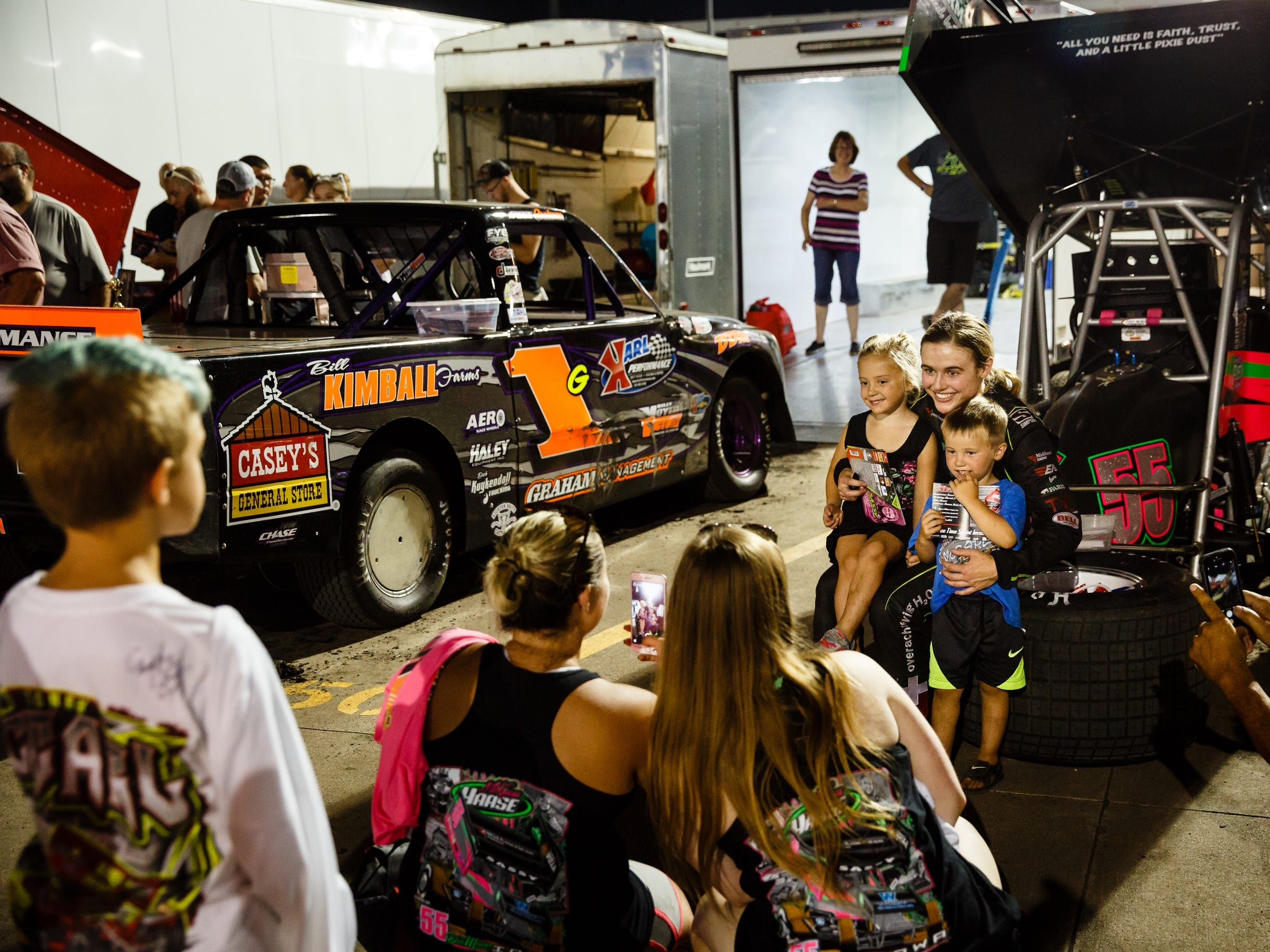 After the races, families line up to get photos and autographs from McKenna Haase behind her car on Saturday, July 14, 2018, in Knoxville.