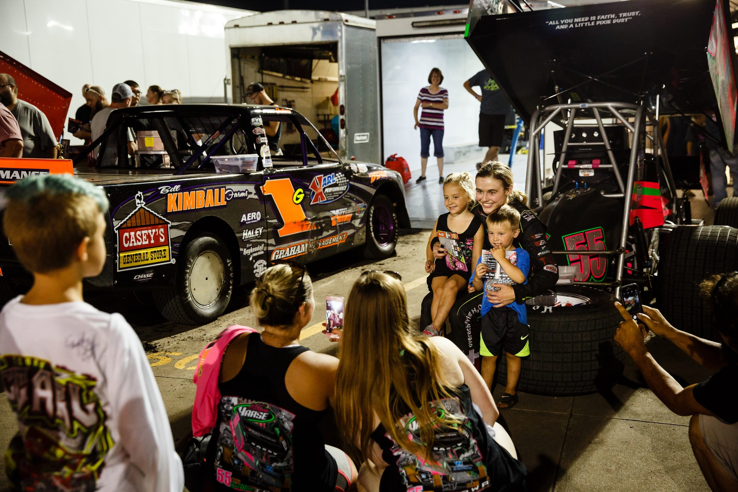 After races at Knoxville, families line up to get photos and autographs from sprint car driver McKenna Haase behind her car on Saturday, July 14, 2018.