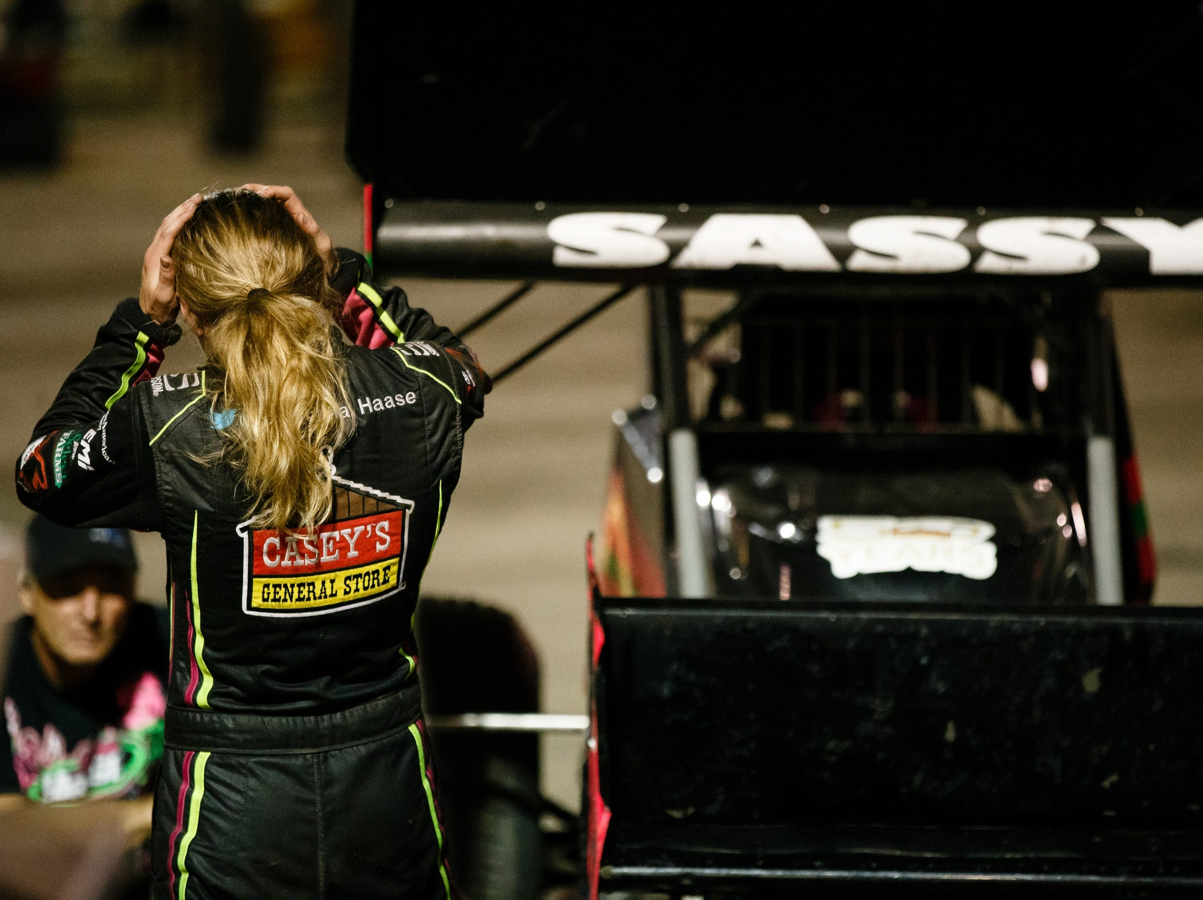 Driver of the 55 sprint car McKenna Haase, 21, talks her mechanic after hot laps on Saturday, July 14, 2018, in Knoxville. Haase is the youngest winningest racer in Sprint Car racing history and is also the only woman to win in Sprint Car racing history.