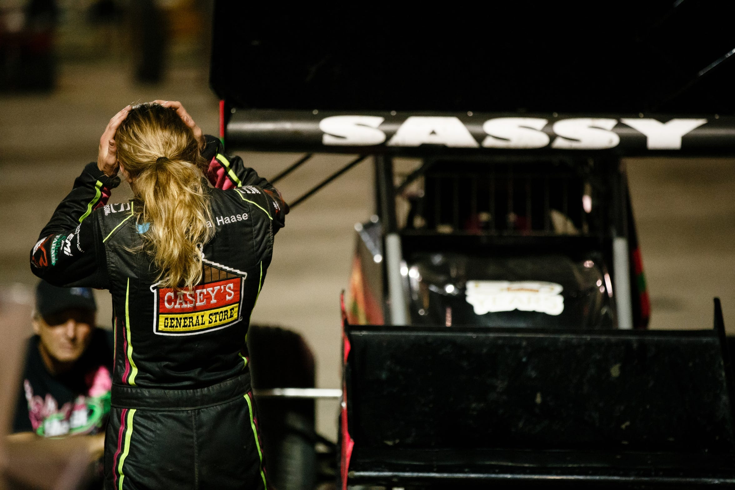 Sprint car driver McKenna Haase, 21, talks her mechanic after hot laps on Saturday, July 14, 2018, in Knoxville.