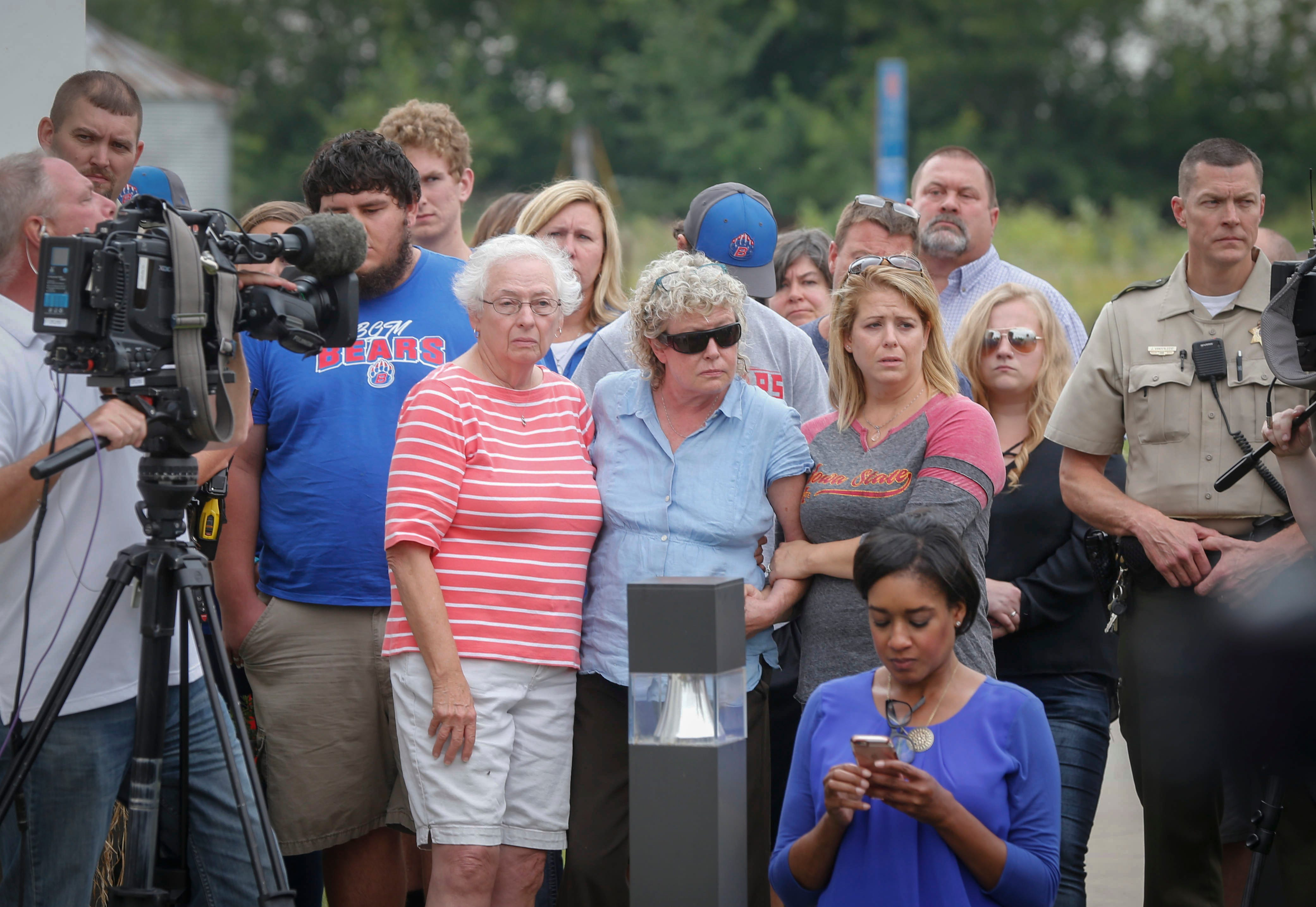 Mollie Tibbetts' family and friends listen to officials at a press conference in Montezuma on Aug. 21, 2018, when law enforcement authorities report they have found Mollie's body.