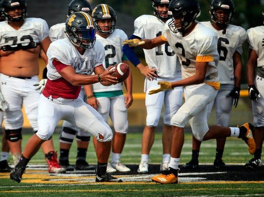 Southeast Polk running back Gavin Williams takes snaps at quarterback during practice Aug. 21, 2018.