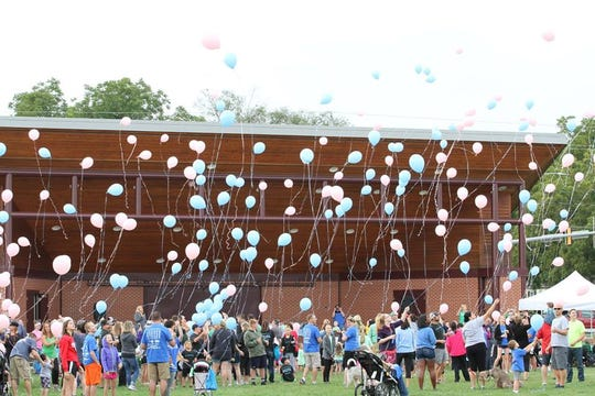 Participants in the annual Iowa SIDS Foundation's Walk for the Future release balloons in Ankeny's Wagner Park to honor babies who died as a result of sudden infant death syndrome.