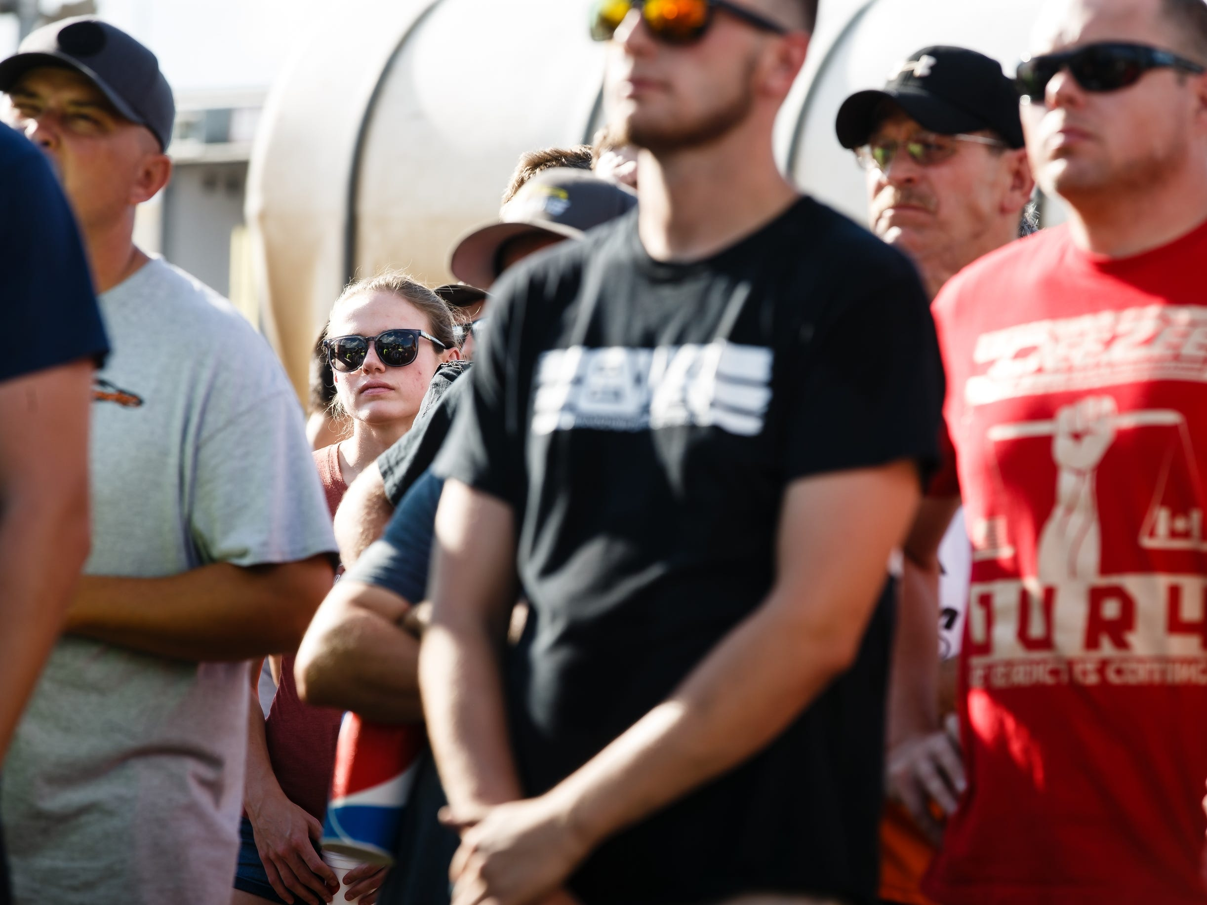 Driver of the 55 sprint car McKenna Haase, 21, stands and listens to race officials brief drivers before racing begins on Saturday, July 14, 2018, in Knoxville. Haase is the youngest and winningest racer in Sprint Car racing history and she is also, the only woman to win in Sprint Car racing history.