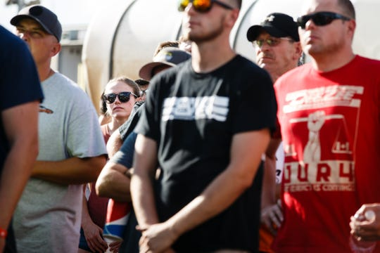 McKenna Haase, 21, listens as race officials brief Sprint Car drivers before racing begins Saturday, July 14, 2018, in Knoxville.