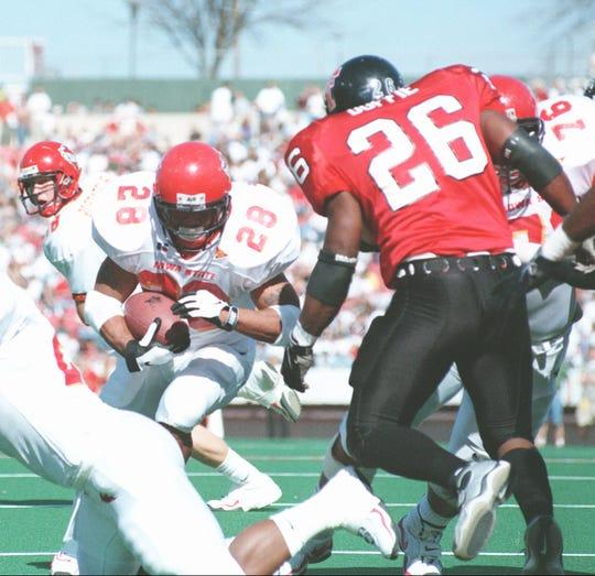 -  -Iowa State running back Darren Davis (28) runs past Texas Tech linebacker Tim Ruffie (26) in the first half Saturday, Nov. 6, 1999, in Lubbock, Texas. (AP Photo/Lubbock Avalanche-Journal, Wade Kennedy)-  -Caption:Iowa State's Darren Davis runs past Texas Tech linebacker Tim Ruffie for yardage Saturday.