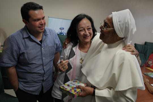 """Joe Avila and Gloria Rodriguez of the Ford Fund share a moment together with sister Virgenmina Morell, 75, at Centros Sor Isolina Ferré in Ponce in Puerto Rico on Tuesday, July 24, 2018.""""The winds of Maria have gone. The direct hits are past, but the hurricane is still inside people, inside of families,"""" said sister Virgenmina Morell, 75 who is dedicated to helping others and attended a Ford Fund sponsored workshop on how to manage your emotions helping her deal with her own PTSD caused by hurricane Maria and its aftermath."""