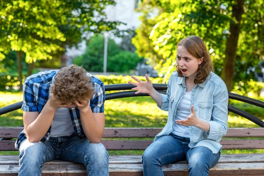 The Girl Screams At Young Man Summer In Park On A Bench The Guy Is Crying And Sad Clasping His Head In His Hands Scandal In Family The Concept Of Aggression And The Problem In Relationship