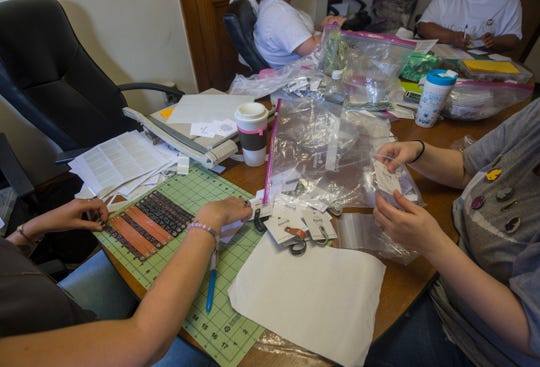 Women works on jewelry at Mend On The Move, a nonprofit were survivors of abuse and addiction create and sell handcrafted jewelry, located at Heartline Samaritas in Detroit on Thursday, August 2, 2018.