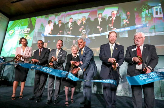 City Council President Pro-Tem Mary Sheffield, Police Chief James Craig,  Ilitch Holdings, Inc. Chris Ilitch, Co-founder of Little Caesars Pizza Marian Ilitch, WSUn President M. Roy Wilson, WSU Board of Governors David A. Nicholson, and Robert Forsythe, dean of WSU Mike Ilitch School of Business, open the Mike Ilitch School of Business at WSU's downtown campus in Detroit on Tuesday, Aug. 21, 2018.