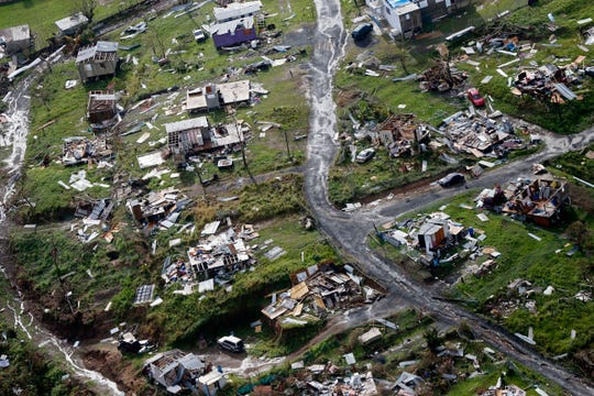 In this Sept. 28, 2017 file photo, destroyed communities are seen in the aftermath of Hurricane Maria in Toa Alta, Puerto Rico.