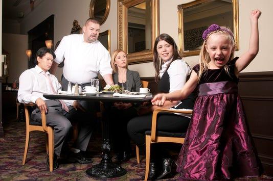 Misbehaving Girl In Restaurant