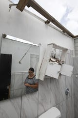 Only the walls of Carmen Rivera's bathroom stand after her home was devastated by Hurricane Maria in Humacao, Puerto Rico on Wednesday, July 25, 2018.