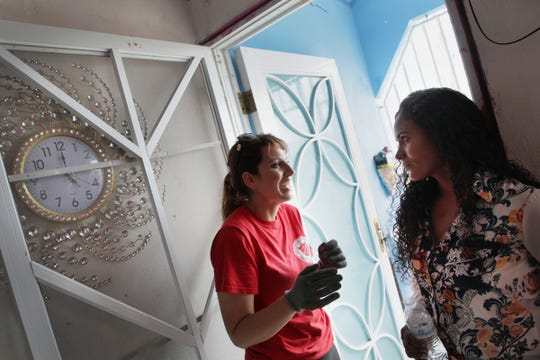 Nicky Roy, Salvation Army coordinator for long-term recovery, left and Taina Castro Cruz, 38, a former receptionist who assists the Salvation Army helping others talk during a house visit in Yabucoa, Puerto Rico on Wednesday, July 25, 2018.