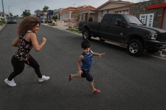 Ashlie Camilo Sosa, 20 and her 5 year old son Jonathan Diaz play outside their home in Toa Alta in Puerto Rico on Thursday, July 26, 2018. Sosa and her son benefited from strong support from Proyecto Nacer, a support network for young parents supported in part by the Ford Fund.