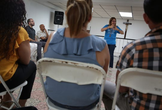 """Lourdes Ortiz, a Social Worker and director of Instituto para el Desarrollo Humano a Plenitud leads a workshop called """"Managing your emotions after Maria"""" in Utuado, Puerto Rico on Friday, July 27, 2018. The workshop is sponsored by the Ford Fund and helps people learn how to deal with their  feelings and emotions in relation to the trauma experienced in the aftermath of hurricane Maria."""