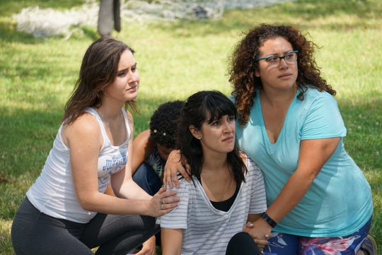 """Rehearsal for Shakespeare in Detroit's """"Much Ado Para Nada,"""" which opens in Clark Park Thursday. From left, Meredith Deighton, Jowi Estava and Carolina Morones."""