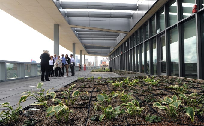 Visitors look around the terrace of the new Mike Ilitch School of Business at Wayne State University, Tuesday, August 21, 2018.   The school held its ribbon-cutting and gave a media tour of the building.