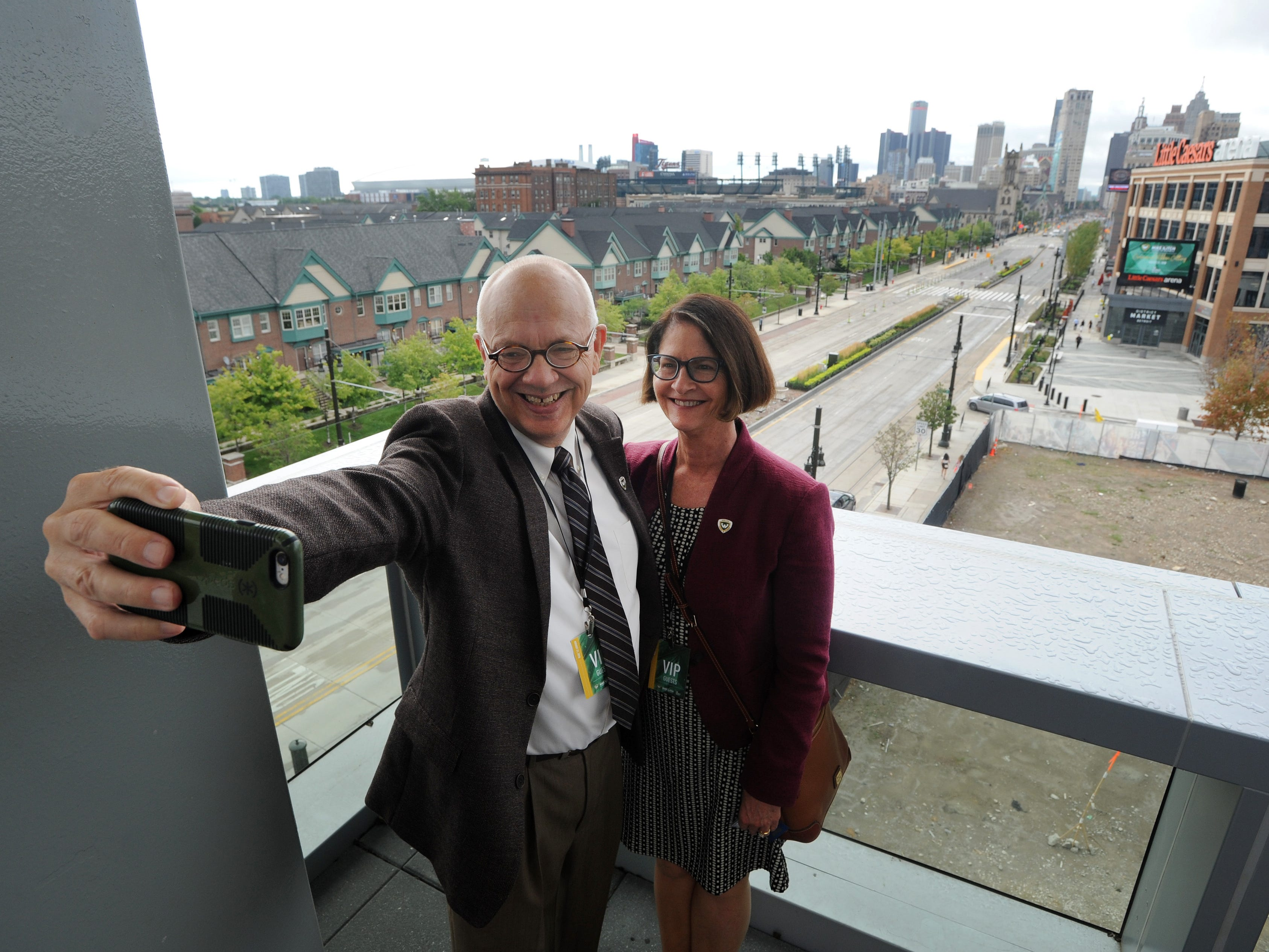 Wayne State University Professor Tim Butler takes a selfie with his wife, Beverly Butler, on the terrace of the Mike Ilitch School of Business.