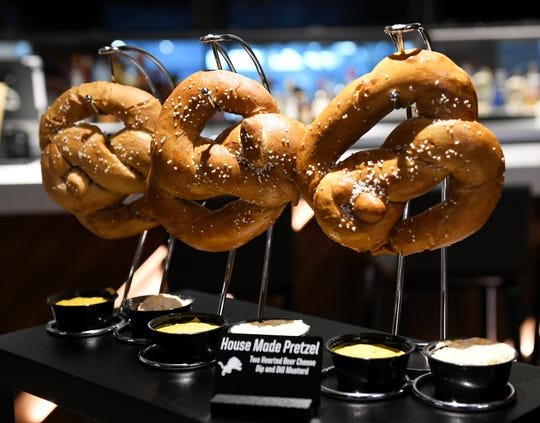 House made pretzels with Two Hearted beer cheese and dill mustard, among the new food and concession choices at Ford Field in Detroit. Photos take on Aug. 14, 2018. 