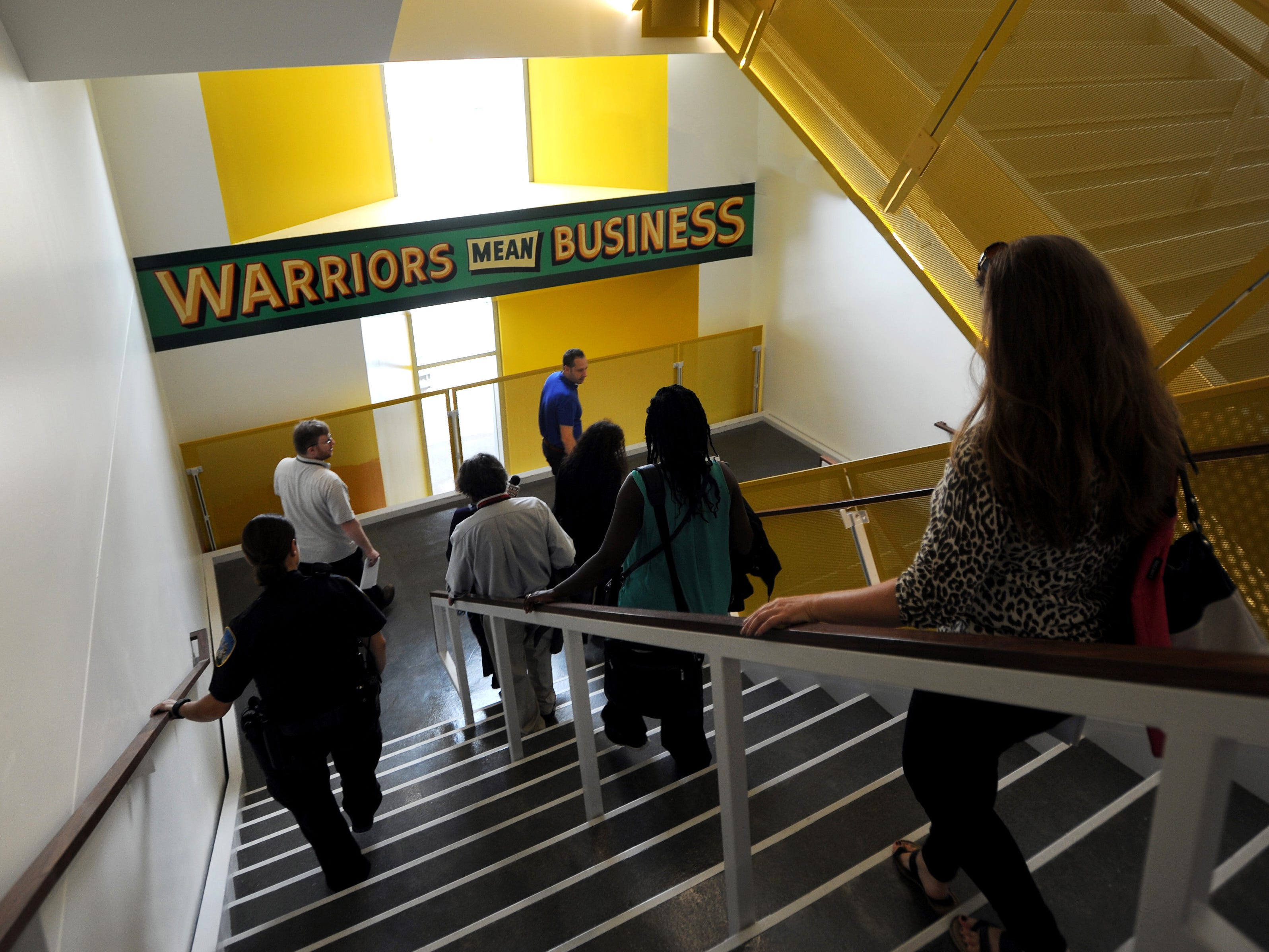 Stairwells on every level are painted with words or paintings at the Mike Ilitch School of Business at Wayne State University.