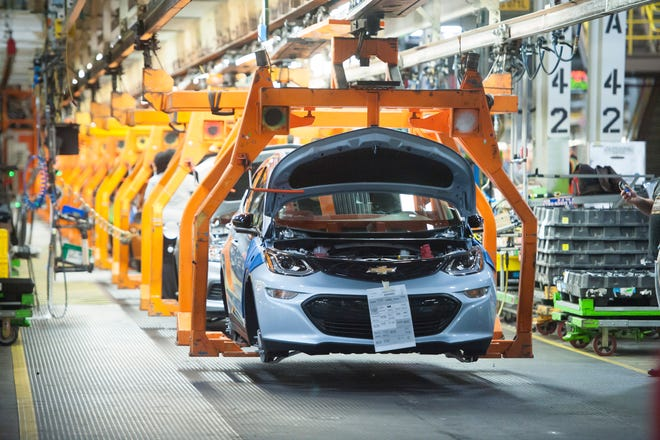 A Chevrolet Bolt EV makes its way down the assembly line at the General Motors assembly plant in Lake Orion.
