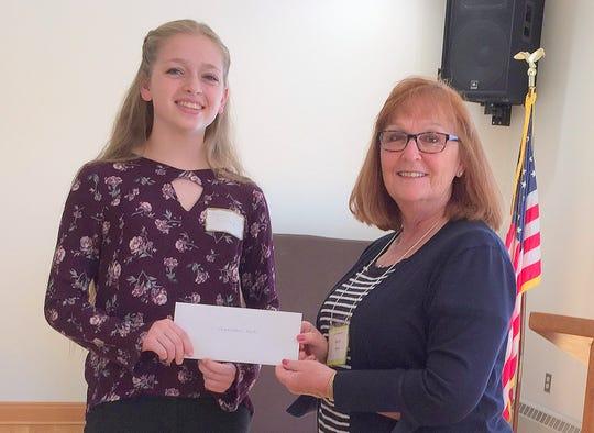 Big Flats Women's Club scholarship chair Bobbie Vence, right, presents a $500 scholarship check to Kaitlin Barkley.