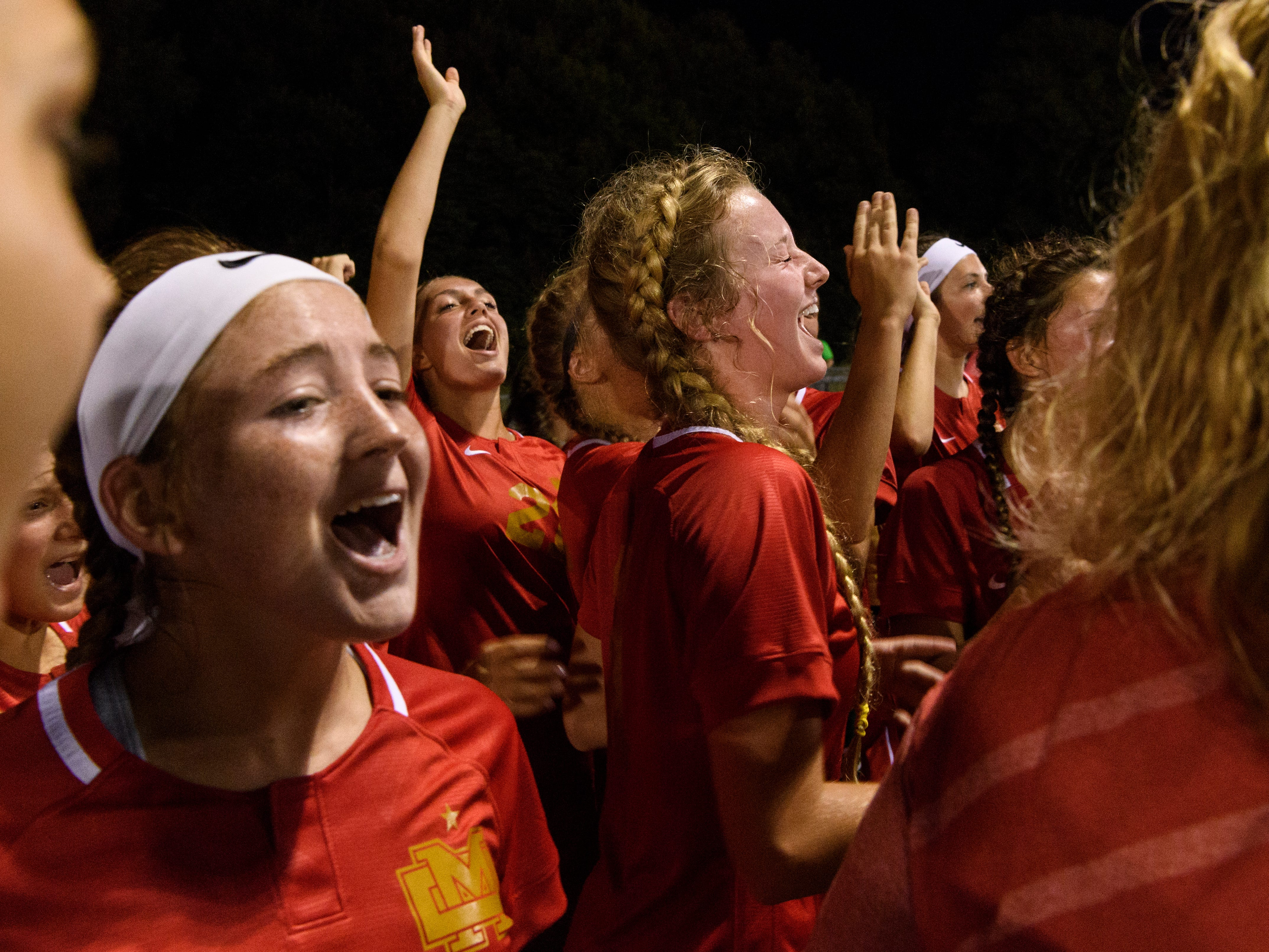 The Mater Dei Wildcats cheer together during a halftime huddle against the Memorial Tigers at the EVSC Soccer Fields in Evansville, Ind., Monday, Aug. 20, 2018. The Tigers defeated the Wildcats 4-0.