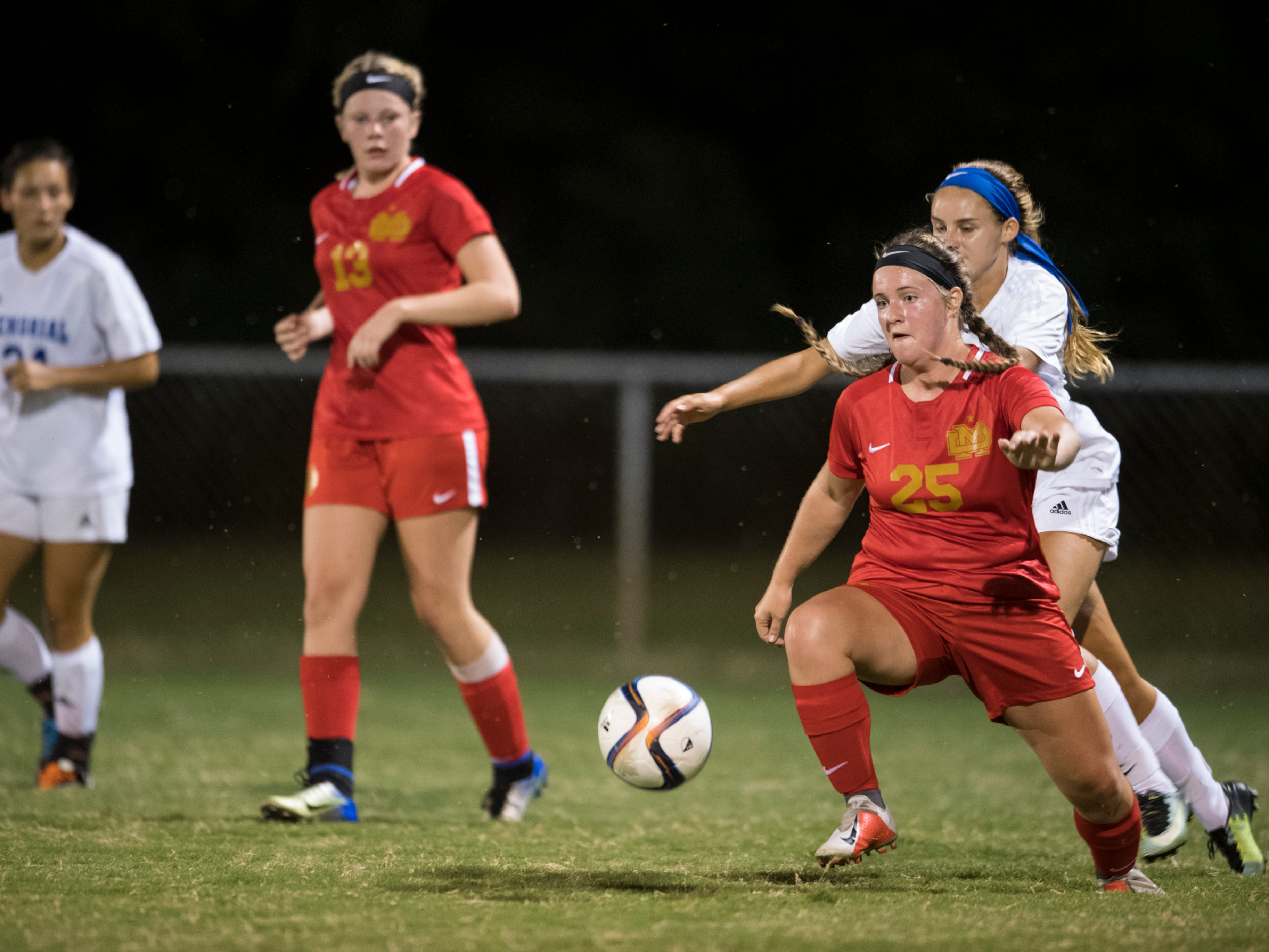 Mater Dei's Macey Adler (25) blocks Memorial's Kelly Bersch (8) from the ball at the EVSC Soccer Fields in Evansville, Ind., Monday, Aug. 20, 2018. The Tigers defeated the Wildcats 4-0.