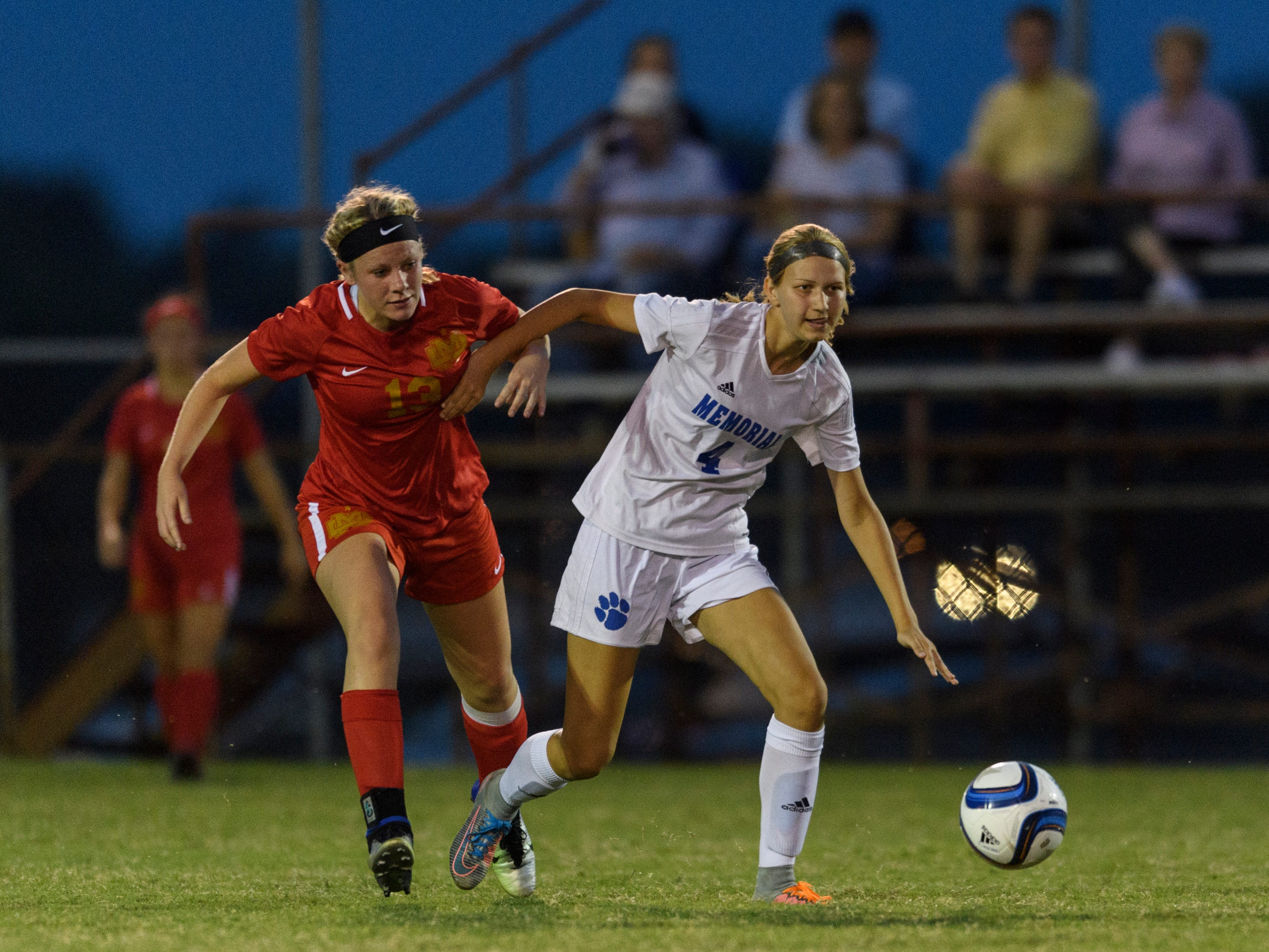 Mater Dei's Katherine Hahn (13) guards Memorial's Abby Burger (4) during the match at EVSC Soccer Fields in Evansville, Ind., Monday, Aug. 20, 2018. The Tigers defeated the Wildcats 4-0.