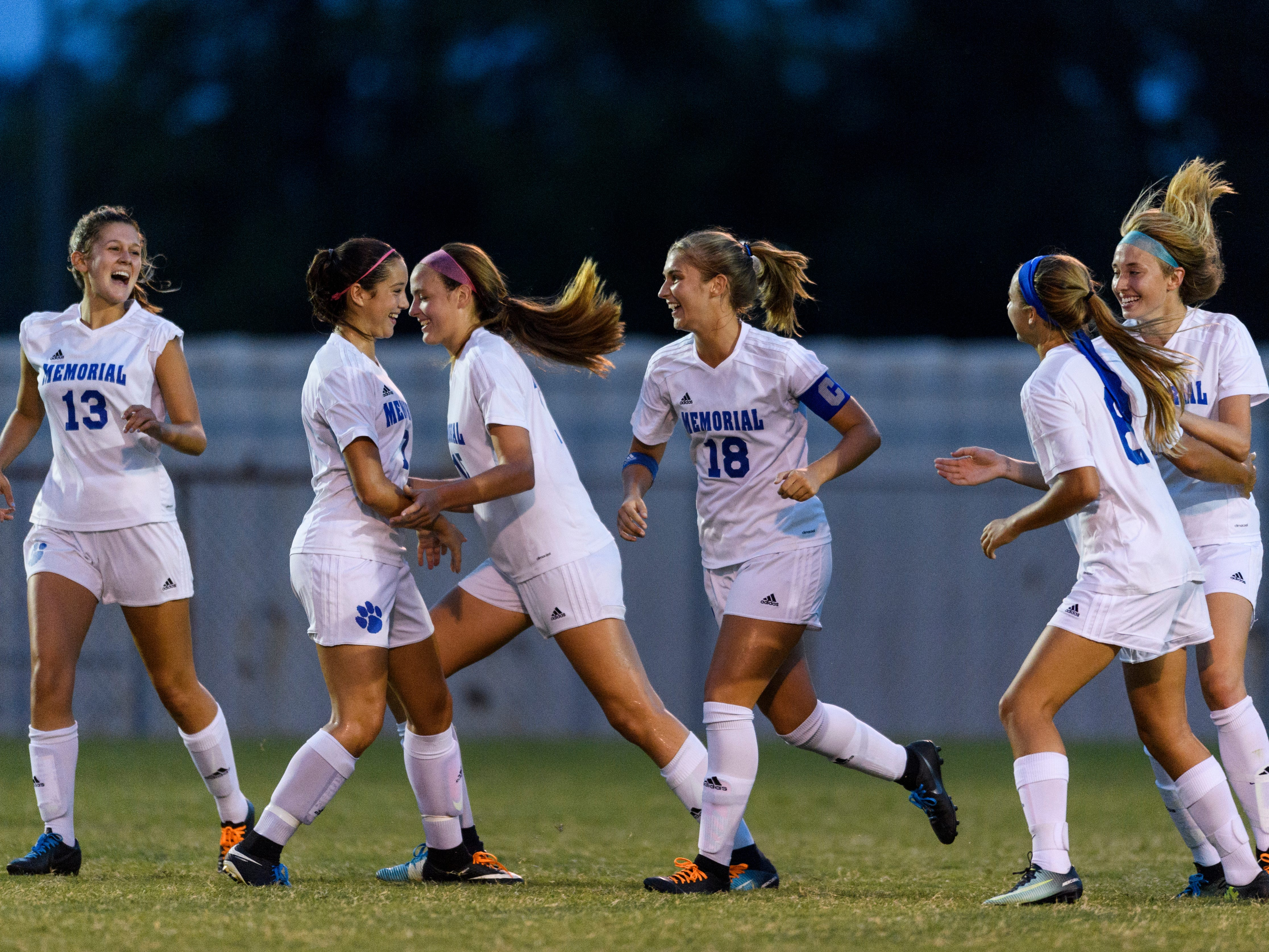 The Memorial Tigers cheer together after Memorial's Annah Hopkins (18) scored a goal on the Mater Dei Wildcats Memorial Tigers at the EVSC Soccer Fields in Evansville, Ind., Monday, Aug. 20, 2018. The Tigers defeated the Wildcats 4-0.