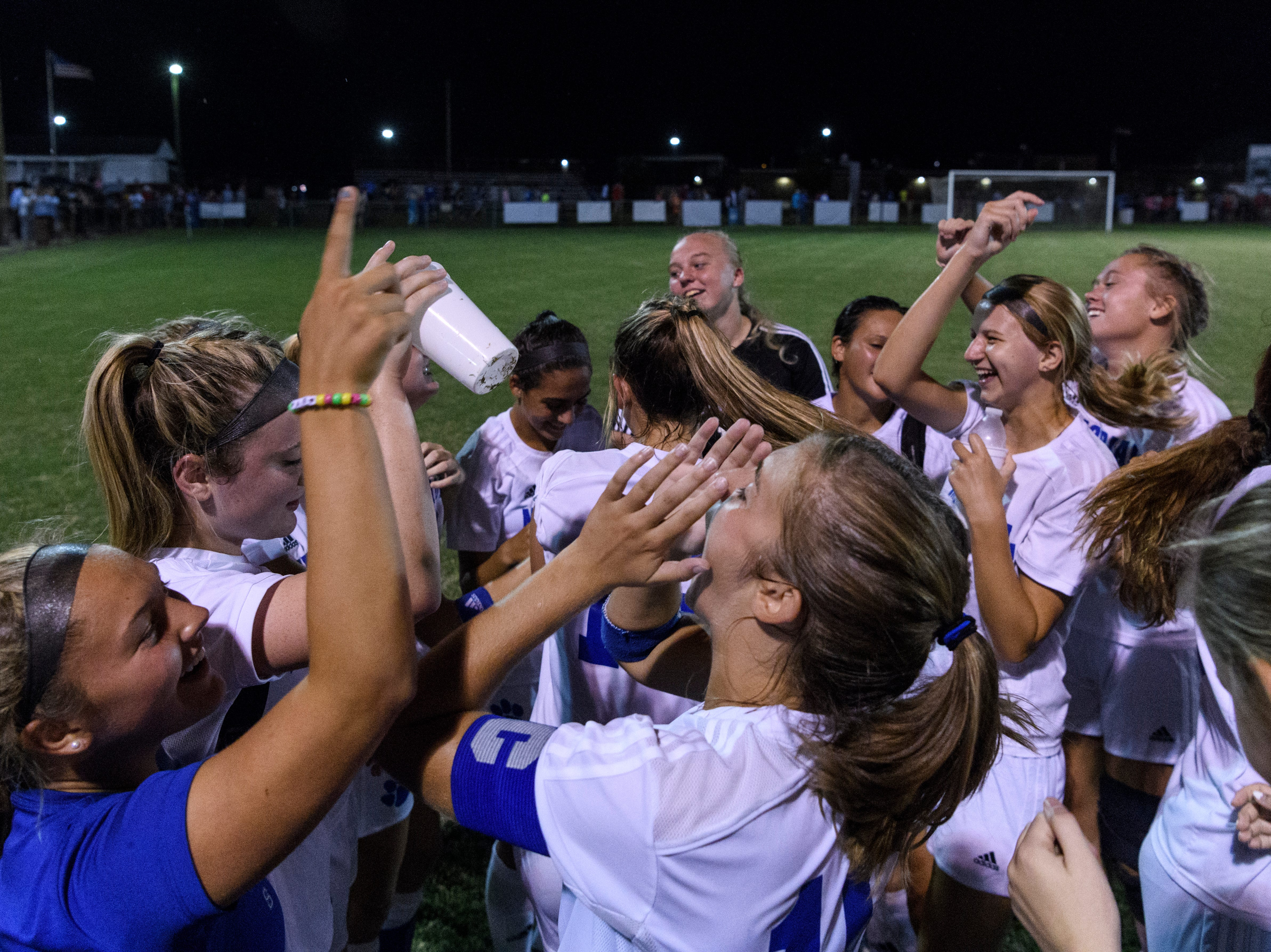 The Memorial Tigers celebrate their 4-0 victory over the Mater Dei Wildcats at the EVSC Soccer Fields in Evansville, Ind., Monday, Aug. 20, 2018.