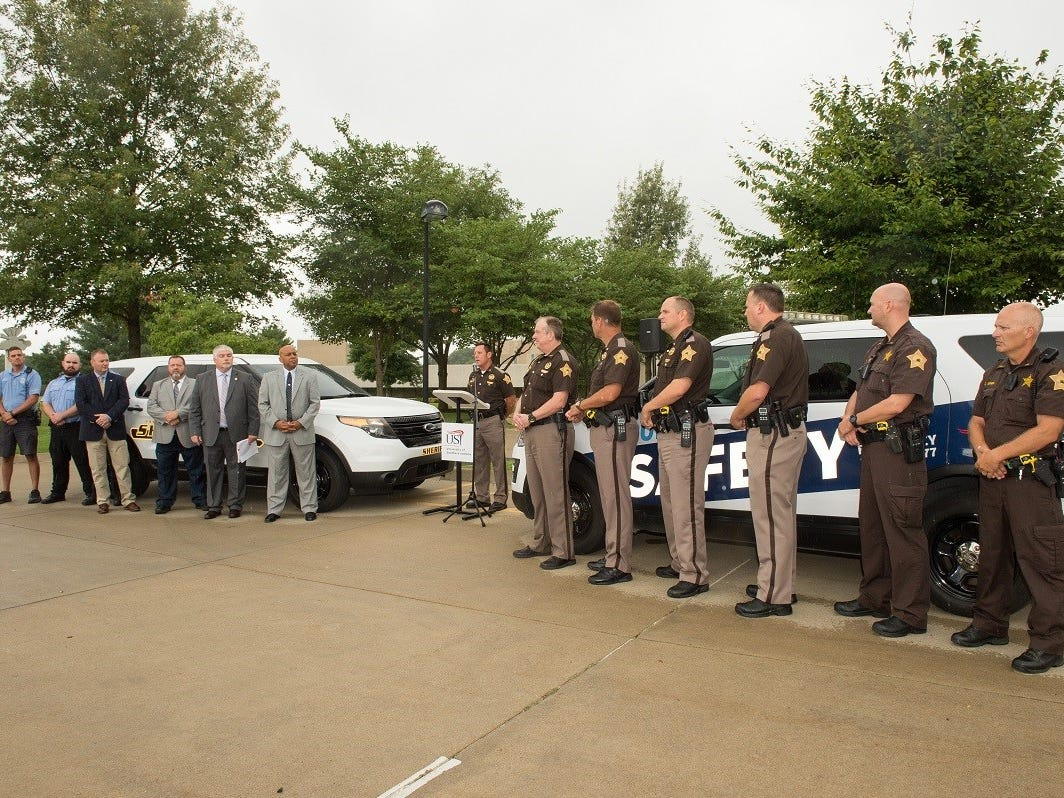 USI President Ronald Rochon and Vanderburgh County Sheriff Dave Wedding announce a new partnership at a recent press conference to add five full-time deputies to USI's campus.