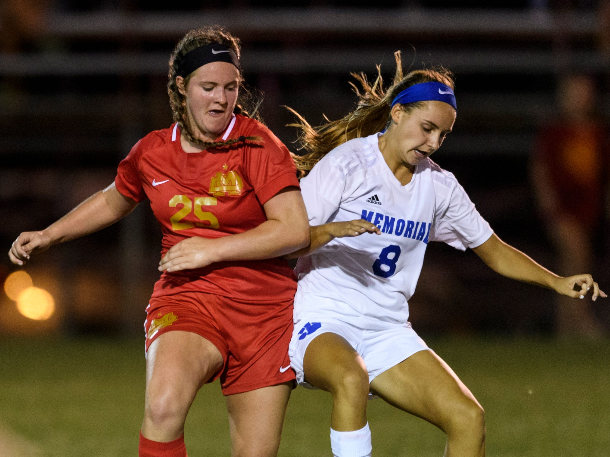 Mater Dei's Macey Adler (25) and Memorial's Kelly Bersch (8) fight for possession during the match at the EVSC Soccer Fields in Evansville, Ind., Monday, Aug. 20, 2018. The Tigers defeated the Wildcats 4-0.