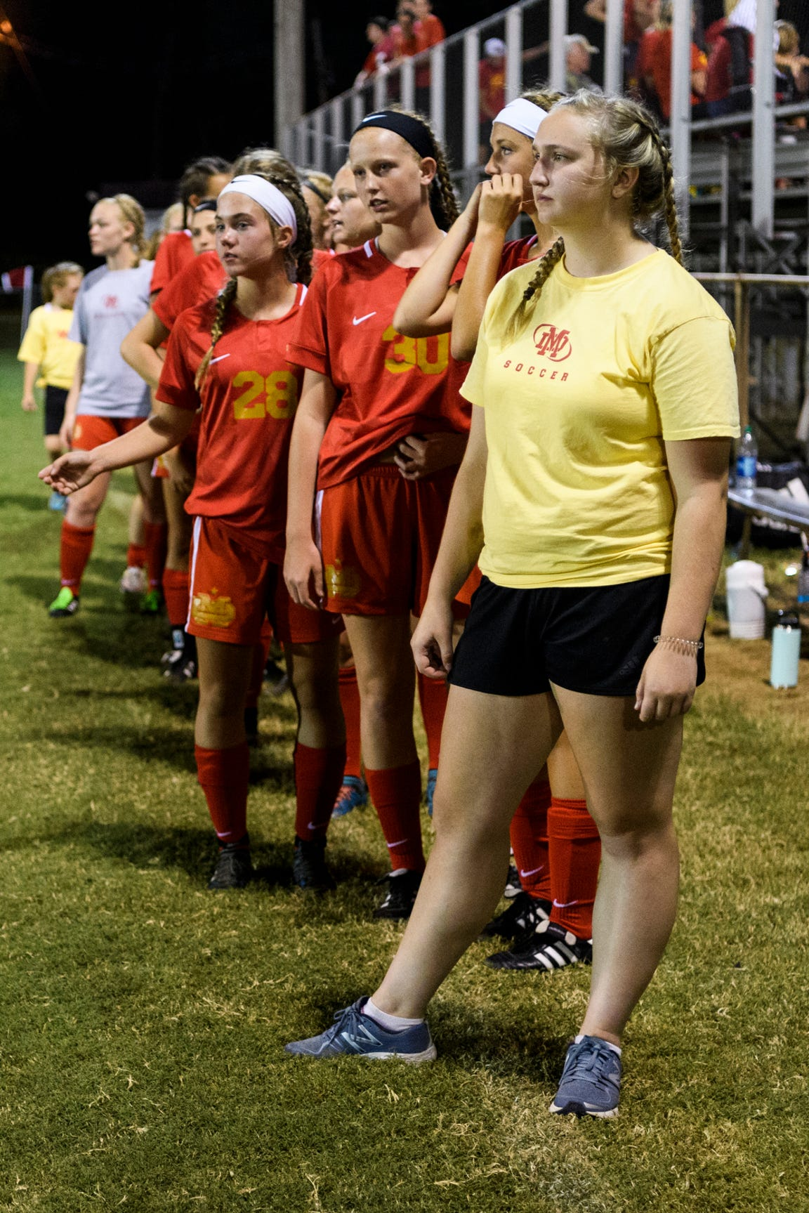 Mater Dei's Anna Bury (10), front, stands with her teammates on the sideline after taking on the Memorial Tigers at the EVSC Soccer Fields in Evansville, Ind., Monday, Aug. 20, 2018. The Tigers defeated the Wildcats 4-0.