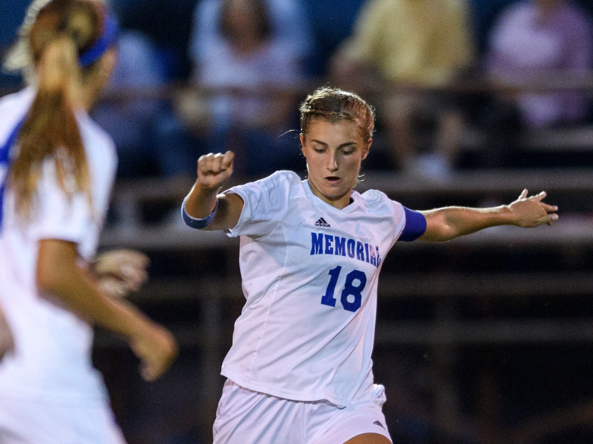 Memorial's Annah Hopkins (18) makes a pass during the game against the Mater Dei Wildcats at the EVSC Soccer Fields in Evansville, Ind., Monday, Aug. 20, 2018. The Tigers defeated the Wildcats 4-0.