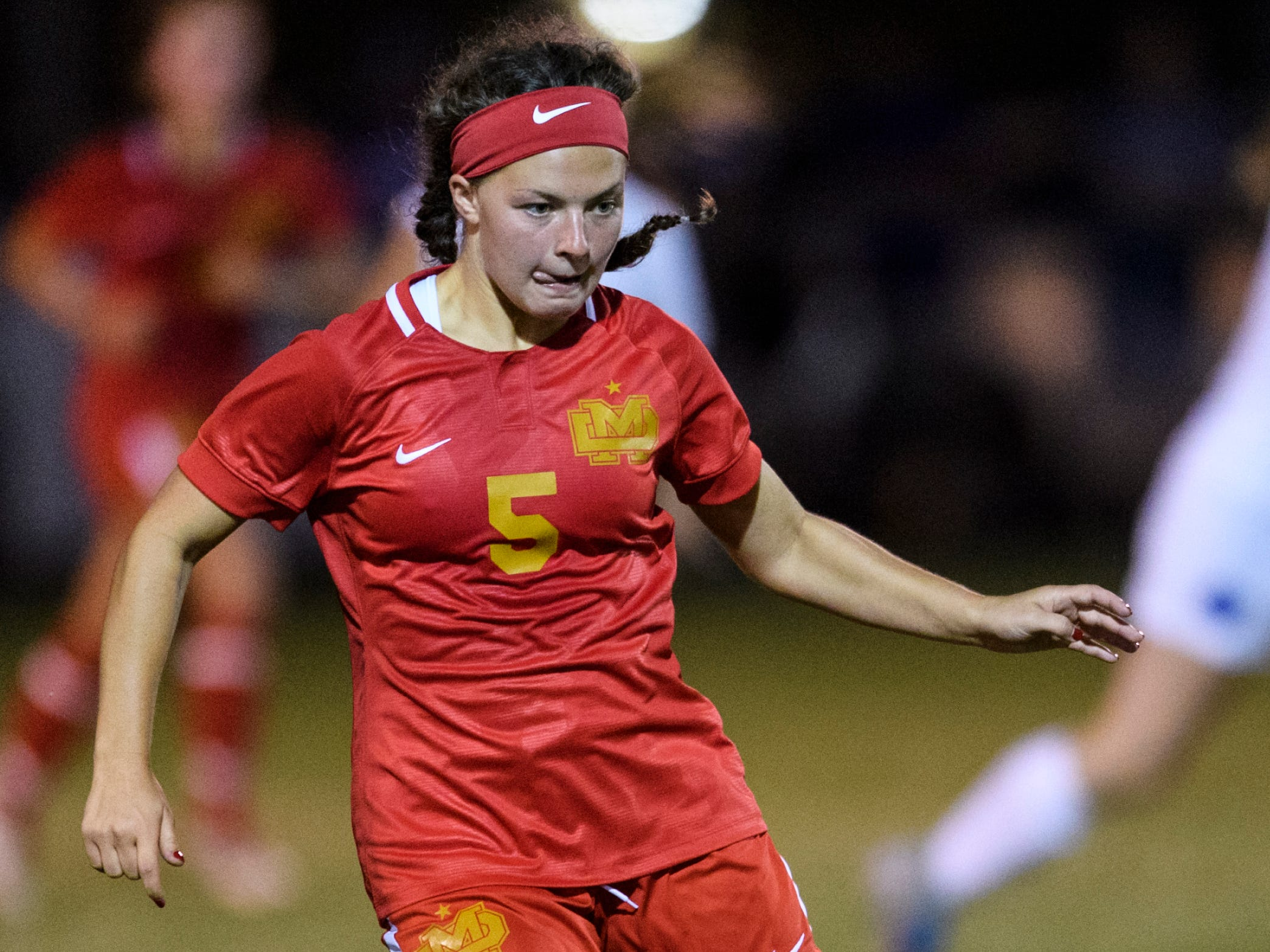 Mater Dei's Jessica Marquis (5) advances down the field during the second half against the Memorial Tigers at the EVSC Soccer Fields in Evansville, Ind., Monday, Aug. 20, 2018. The Tigers defeated the Wildcats 4-0.