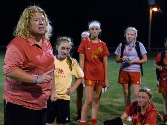 Mater Dei coach Amy Weber (left) is the Courier & Press All-Metro Coach of the Year. The Wildcats won their second straight state championship.