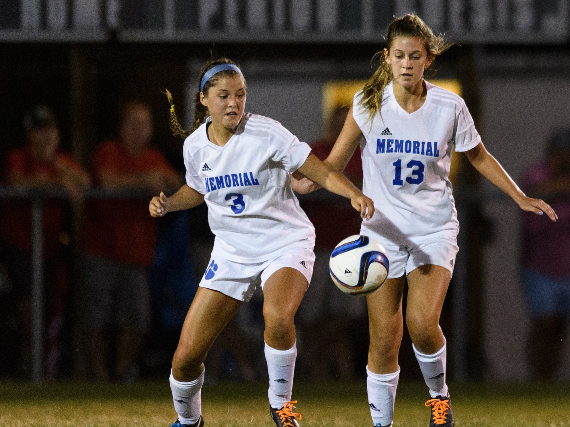 Memorial's Sydney Ulrich (3) and Memorial's Eve Timmons (13) take on the Mater Dei Wildcats at the EVSC Soccer Fields in Evansville, Ind., Monday, Aug. 20, 2018. The Tigers defeated the Wildcats 4-0.