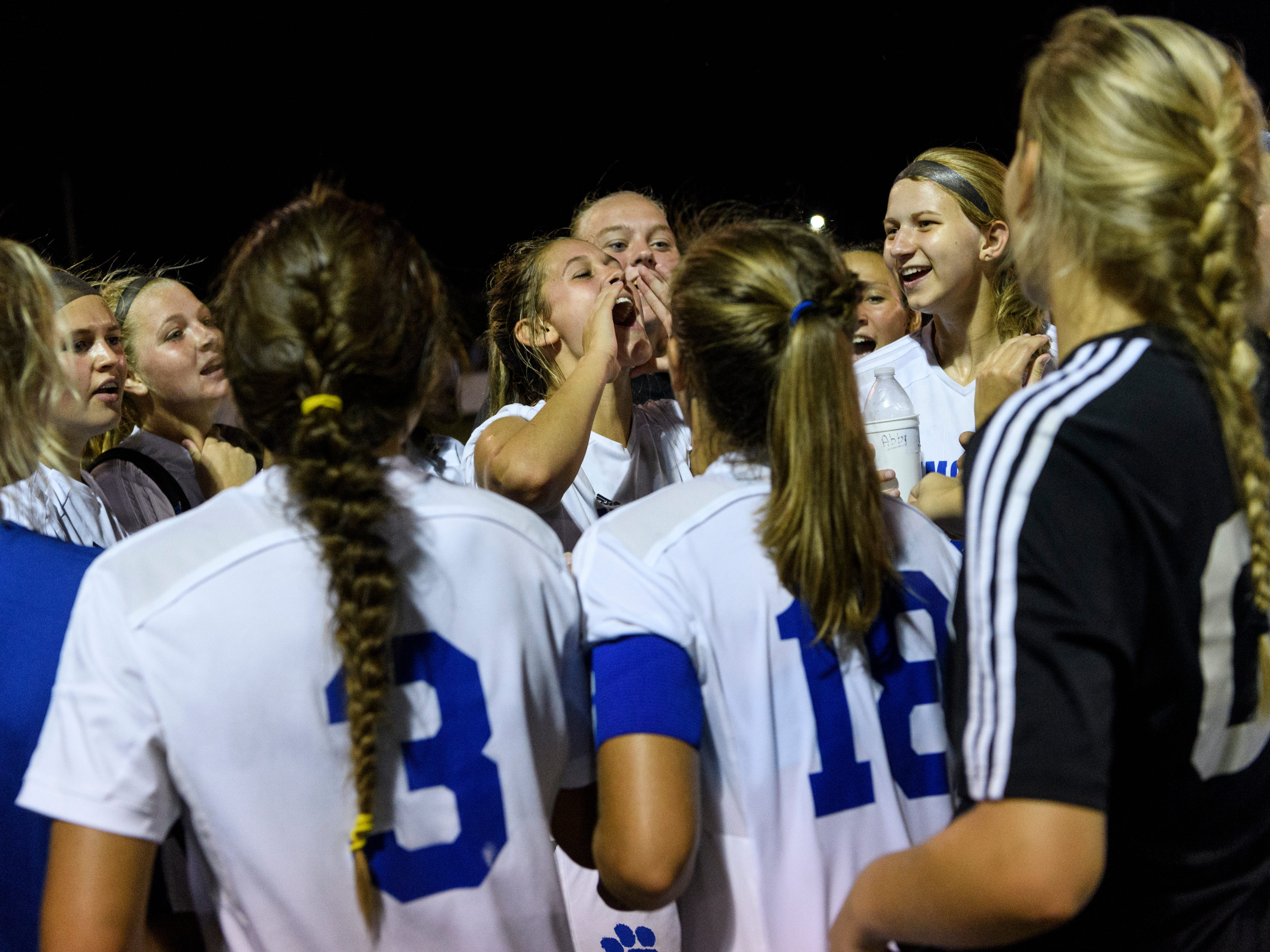 The Memorial Tigers huddle and cheer together after defeating the Mater Dei Wildcats 4-0 at the EVSC Soccer Fields in Evansville, Ind., Monday, Aug. 20, 2018.