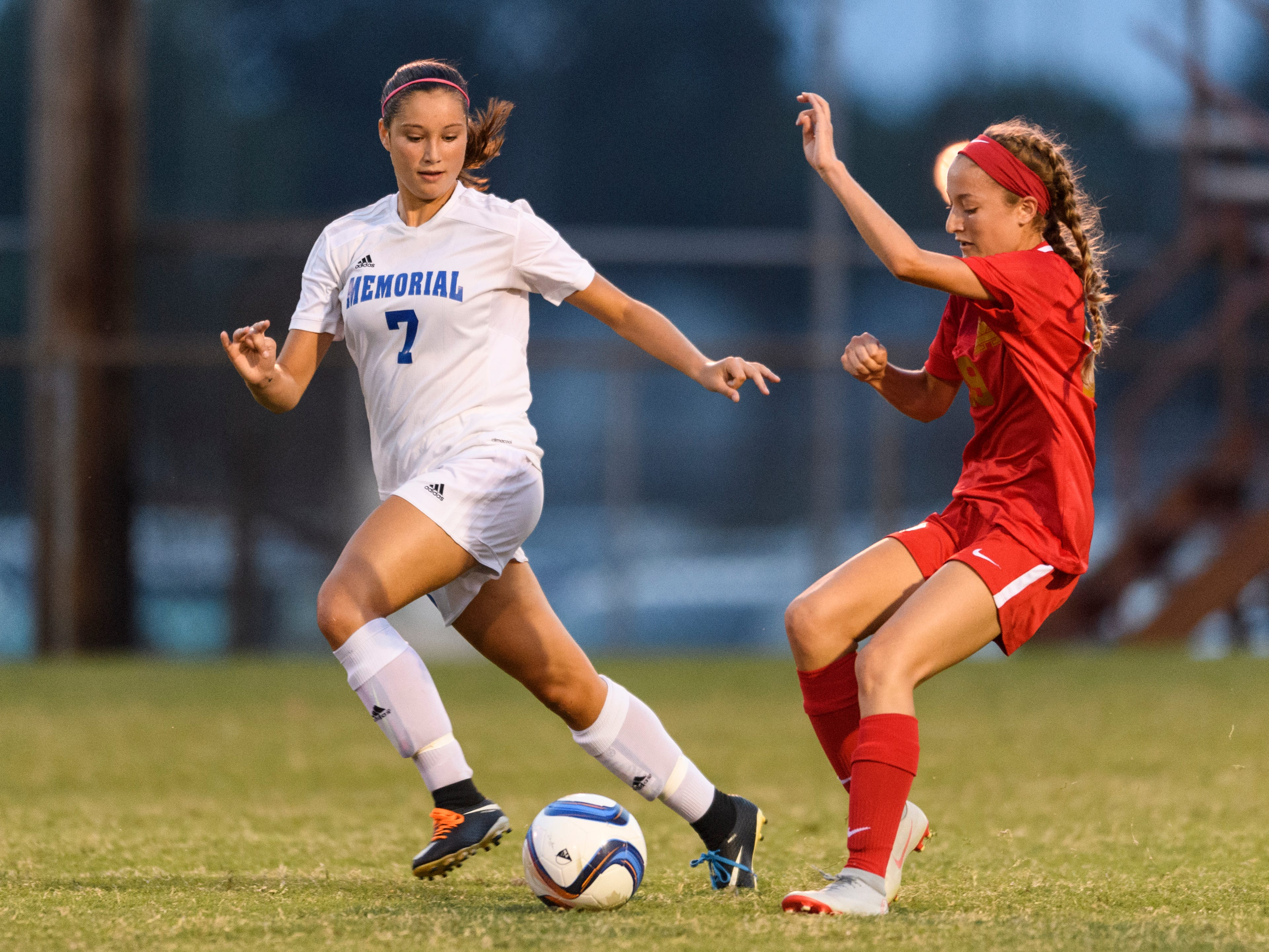 Memorial's Mallory Wittmer (7) attempts to make a steal from Mater Dei's Miranda Nosko (19) during the match up at the EVSC Soccer Fields in Evansville, Ind., Monday, Aug. 20, 2018. The Tigers defeated the Wildcats 4-0.