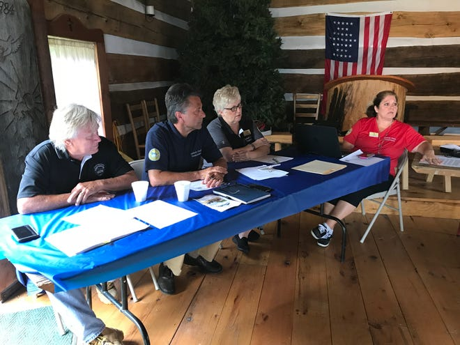 Sandusky County Commissioners Charlie Schwochow, left, Scott Miller, middle, and Kay Reiter host a meeting at the Sandusky County Fairgrounds Tuesday with administrator Theresa Garcia on the right.