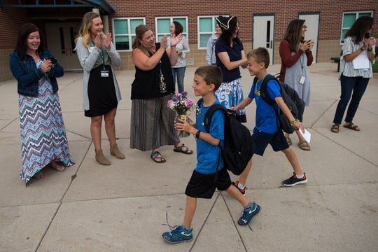 Cache La Poudre Elementary staff welcome students back to school for the first day of the 2018-2019 school year on Tuesday, Aug. 21, 2018, at Cache La Poudre Elementary School in Laporte, Colo.