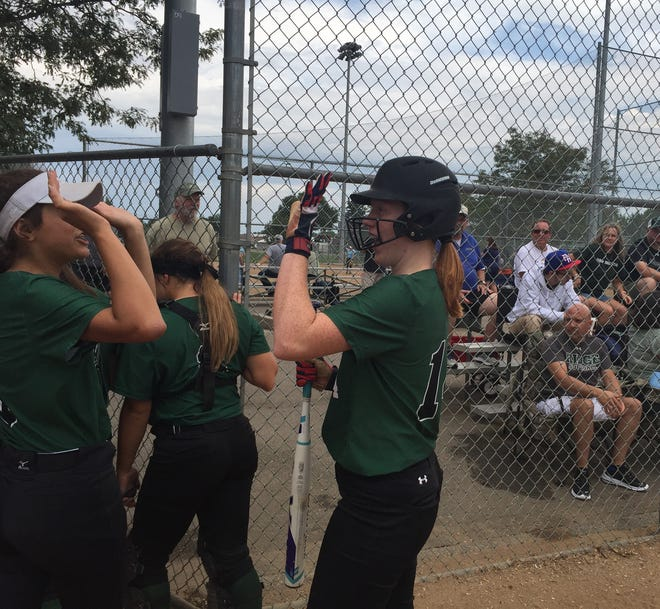 Fossil Ridge senior Kristen Reed, right celebrates after hitting a home run in Saturday's 4-3 loss to Mountain View in Loveland. The SaberCats, who entered the Loveland Classic as the No. 2-ranked Class 5A team, went 2-2 in the tournament.